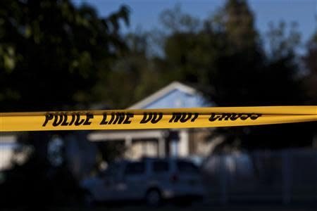 Police tape marks the scene of a shooting in Sacramento
