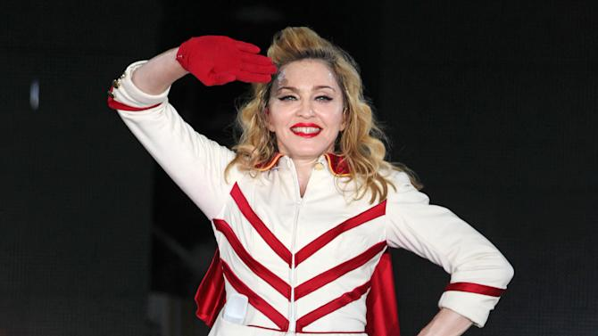 """U.S. singer Madonna performs during her concert at Olympic Hall in Moscow, Russia, Tuesday, Aug. 7, 2012. Madonna has voiced hope that three feminist Russian rockers on trial for performing a """"punk prayer"""" against Vladimir Putin are released soon. The pop star told the AP during her concert tour of Russia that she supports freedom of speech and hopes the judge will show leniency. (AP Photo/Mikhail Metzel)"""