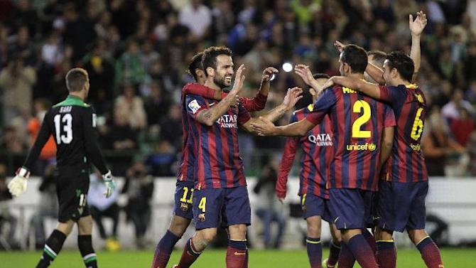 Barcelona's Francesc Fabregas, left, celebrates with teammates after scoring against Betis during their La Liga soccer match at the Benito Villamarin stadium, in Seville, Spain, Sunday, Nov. 10, 2013
