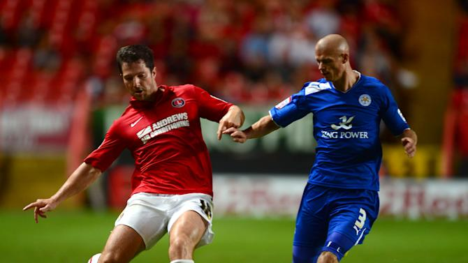 Yann Kermorgant, left, scored against his former club