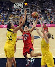 Australia's center Elizabeth Cambage, left, and forward Rachel Jarry, right, challenge United States' guard Diana Taurasi during their semifinal women's basketball game at the 2012 Summer Olympics on Thursday, Aug. 9, 2012, in London. (AP Photo/Mark Ralston, Pool)