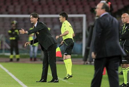 AC Milan's coach Inzaghi reacts during their Italian Serie A soccer match against Napoli at the San Paolo stadium in Naples