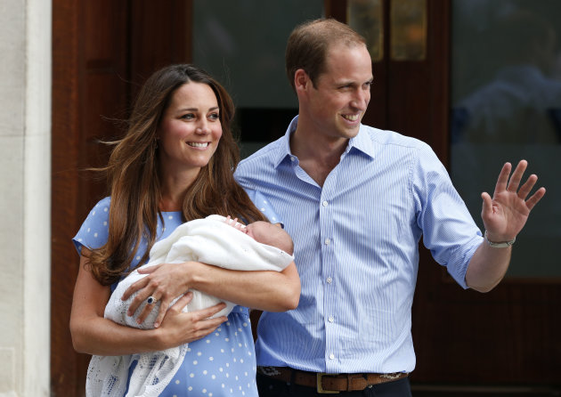 Prince William and Kate, Duchess of Cambridge hold the Prince of Cambridge, as they pose for photographers outside St. Mary's Hospital with George (AP Photo/Lefteris Pitarakis, File)