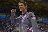 US swimmer Michael Phelps poses with the gold medal after winning the men's 4x100 medley relay final during the swimming event at the London 2012 Olympic Games