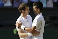 Britain's Andy Murray (L) embraces Serbia's Novak Djokovic after Murray's victory in the men's singles final on day thirteen of the 2013 Wimbledon Championships at the All England Club in Wimbledon, southwest London, on July 7, 2013. Djokovic and Murray have now contested three of the last four Grand Slam finals