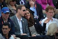 Britain's Duke of Cambridge William (L), Duchess of Cambridge Catherine (C) and Prince Harry (R) look on during the Jumping Phase of the Eventing competition of the 2012 London Olympics at the Equestrian venue in Greenwich Park, London, on July 31, 2012