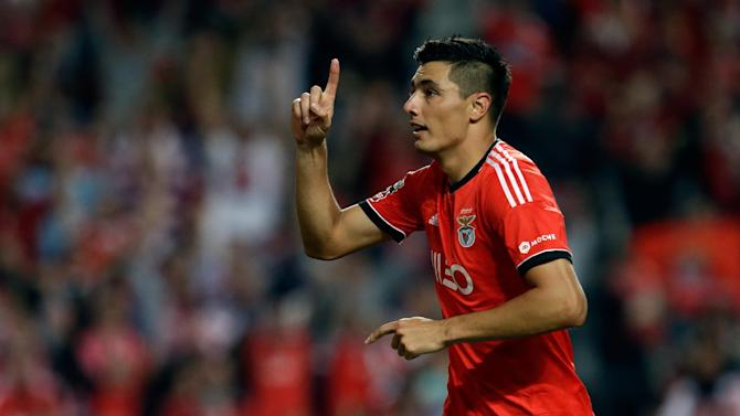 Benfica's Oscar Cardozo, from Paraguay, celebrates after scoring their second goal during their Portuguese league soccer match against Nacional, Sunday Oct. 27, 2013, at Benfica's Luz stadium in Lisbon