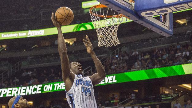 Orlando Magic's Andrew Nicholson (44) lays the ball up as Dallas Mavericks' Vince Carter, left, stands by during the first half of an NBA basketball game in Orlando, Fla., Saturday, Nov. 16, 2013