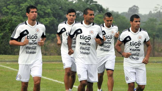 Paraguay's national team players attend a training session in Ypane