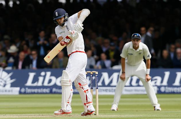England's Mark Wood hits a ball bowled by New Zealand's Trent Boult during play on the second day of the first Test match at Lord's cricket ground in London, Friday, May 22, 2015. (AP Phot