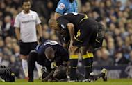 Fabrice Muamba receives treatment after collapsing during the FA Cup quarter-final between Tottenham Hotspur and Bolton Wanderers at White Hart Lane on March 17. Muamba has retired from playing professional football on health grounds, the English second-tier club said on their website Thursday