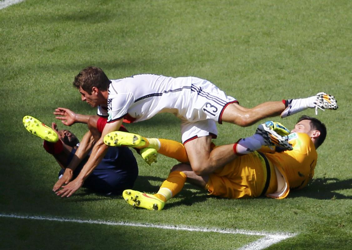 Germany's Thomas Mueller is stopped by France's Evra and Lloris during World Cup quarter-finals at the Maracana stadium
