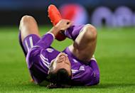 Gareth Bale grimaces as he lies on the pitch during Real Madrid's Champions League game against Sporting in Lisbon on November 22, 2016
