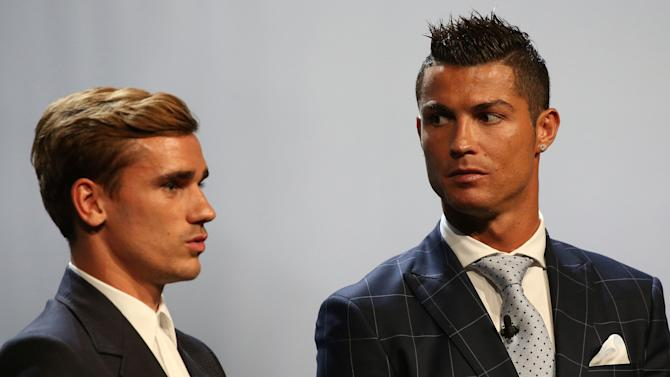 Real Madrid's Ronaldo of Portugal poses with French soccer player Griezmann after he received The Best Player UEFA 2015/16 Award during the draw ceremony for the 2016/2017 Champions League Cup soccer competition