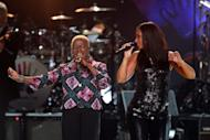 """Alicia Keys (left) and Angelique Kidjo perform at a Mandela Celebration Concert in New York in 2009. The anti-apartheid hero was on a US terror watch list until 2008 and while still on Robben Island, Britain's late """"Iron Lady"""" Margaret Thatcher described his African National Congress as a """"typical terrorist organisation."""""""