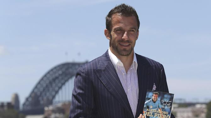 "Sydney FC captain Alessandro Del Piero of Italy poses with his new book ""Playing on"" for photographers during the launch of his autobiography, in Sydney, Australia, Thursday, Nov. 21, 2013"