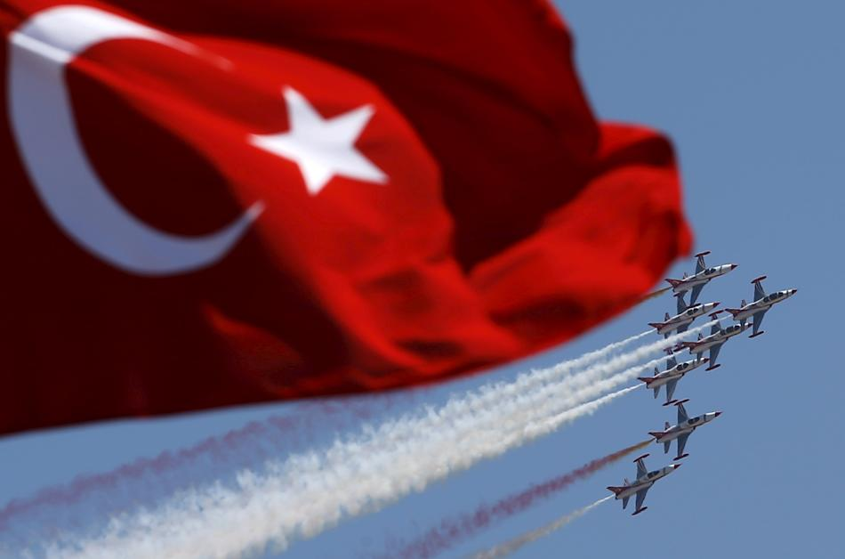 Turkish Stars, the aerobatic team of the Turkish Air Force, perform a manoeuvre during a ceremony marking the 93rd anniversary of Victory Day in Ankara