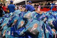 Barisan National Party gift bags are piled up during Malaysian Prime Minister Najib Razak's meeting with parliamentary constituency young voters at his hometown in Pekan on May 4, 2013