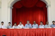 Singapore's Prime Minister Lee Hsien Loong, center, is seated with members of his new Cabinet, from left to right: Ng Chee Meng, Acting Minister for Education (Schools) and Senior Minister of State for Transport; Josephine Teo, Senior Minister of State, Prime Minister's Office, Foreign Affairs and Transport; Khaw Boon Wan, Coordinating Minister for Infrastructure and Minister for Transport; Teo Chee Hean, Deputy Prime Minister and Coordinating Minister for National Security; Tharman Shanmugaratnam, Deputy Prime Minister and Coordinating Minister for Economic and Social Policies; Heng Swee Keat, Minister for Finance; Masagos Zulkifli, Minister for Environment and Water Resources; Ong Ye Kung, Acting Minister for Education (Higher Education and Skills) and Senior Minister of State for Defence, in Singapore, Monday, Sept. 28, 2015. Less than three weeks after a landslide general election win by the ruling party, Singapore announced a new Cabinet structure Monday in a pitch for leadership renewal, with some senior officeholders taking on wider coordinating roles overseeing younger ministers. (AP Photo/Annabelle Liang)