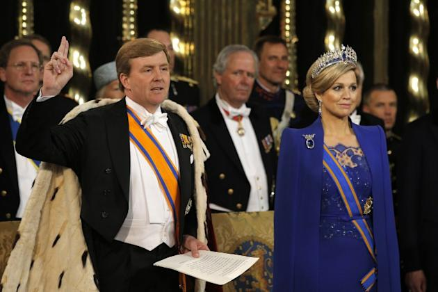 King Willem-Alexander of the Netherlands swears to the constitution next to his wife Queen Maxima during his inauguration ceremony on April 30, 2013 at Nieuwe Kerk (New Church) in Amsterdam.     AFP P