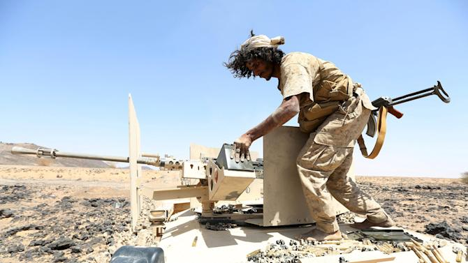 Soldier loyal to Yemen's government stands on a armoured personnel carrier in the frontline province of Marib