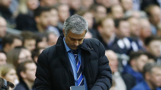 Football: Chelsea manager Jose Mourinho takes notes