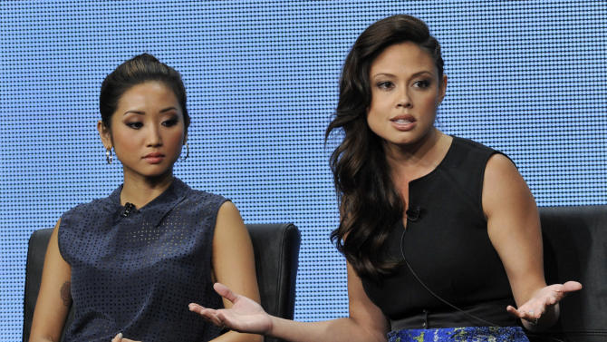 "Vanessa Lachey, right, a cast member on the FOX series ""dads,"" addresses reporters as fellow cast member Brenda Song looks on during a panel discussion on the show at the FOX 2013 Summer TCA press tour at the Beverly Hilton Hotel on Thursday, Aug. 1, 2013 in Beverly Hills, Calif. (Photo by Chris Pizzello/Invision/AP)"