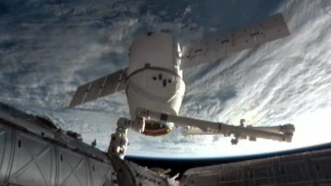 This image provided by NASA-TV shows the SpaceX Dragon commercial cargo craft as it is backed away from the International Space Station early Tuesday March 26, 2013 by the International Space Station's Canadarm2 robotic arm. The Dragon is expected to splash down in the eastern Pacific ocean approximately 246 miles off the coast of Baja Calif., later this morning. (AP Photo/NASA)