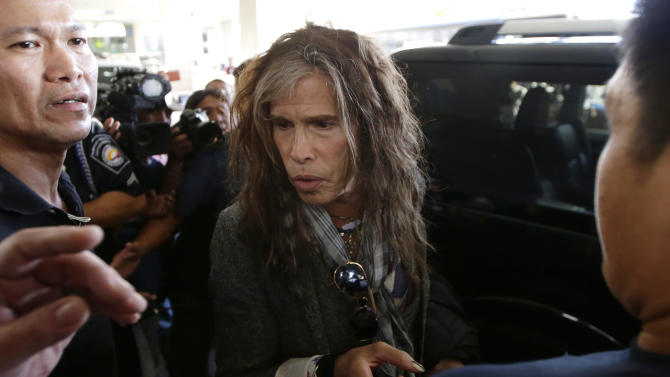 Steven Tyler of the famed Aerosmith rock band gestures before boarding his waiting van upon arrival from Melbourne Sunday May 5, 2013 in Manila, Philippines. Tyler and his entourage are here as part of their band's world tour concert. (AP Photo/Bullit Marquez)