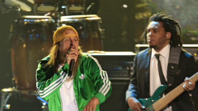 Kid Rock performs with the band, Roots, after the induction of the Beastie Boys into the Rock and Roll Hall of Fame Saturday, April 14, 2012, in Cleveland. (AP Photo/Tony Dejak)