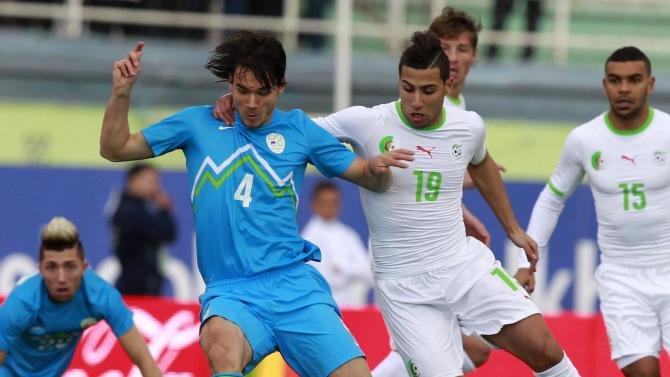 Slovenia's Krhin fights for the ball with Algeria's Taider during their international friendly soccer match in Algiers