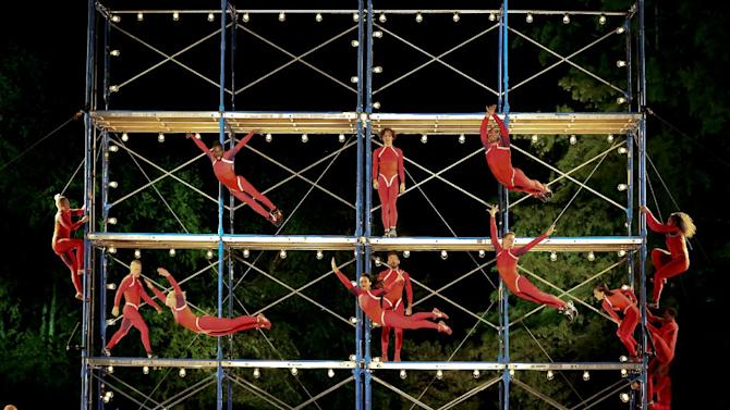 """This Sept. 16, 2013 image released by New York City Center shows the STREB Extreme Action Company performing its """"Human Fountain"""" at the Delacorte Theatre in New York's Central Park as part of the 10th anniversary of the Fall for Dance Festival. (AP Photo/New York City Center, Tammy Shell)"""