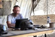 "In this photo released by Spanish newspaper El Periodico de Catalunya on Sunday March 2, 2014, journalist Marc Marginedas who works for the newspaper, sits by his laptop at the Canadian base in Nakhonay, Afganistan in this photo taken on Oct. 10, 2010. Marginedas, who was kidnapped by al-Qaida-linked militants in Syria crossed the border into Turkey on Sunday March 2, 2014 his newspaper reported, as activists said government airstrikes killed at least 13 people in a northwestern border town. Veteran war correspondent Marc Marginedas was abducted on Sept. 4 near Hama by jihadists belonging to the Islamic State of Iraq and the Levant, a breakaway al-Qaida group. He was ""moved repeatedly"" while in captivity and was accused of spying for the West before his release, his newspaper El Periodico said. (AP Photo/Agustin Catalan, El Periodico de Catalunya)"