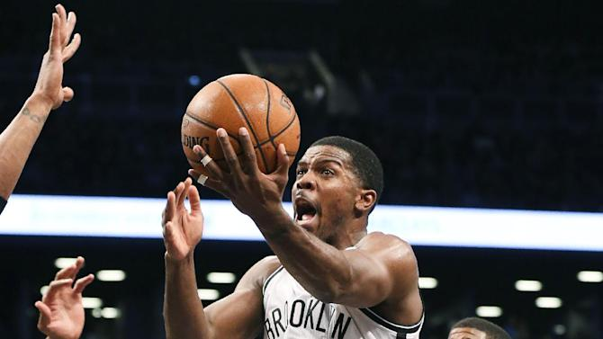 RETRANSMISSION TO CORRECT ID - Brooklyn Nets guard Joe Johnson (7) shoots the ball during the third quarter of a NBA basketball game against the Indiana Pacers, Saturday, Nov. 9, 2013, at the Barclays Center in New York. The Indiana Pacers defeated the Brooklyn Nets 96-91