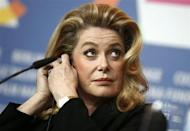 "Actress Catherine Deneuve addresses a news conference to promote the movie ""Elle s'en va"" at the 63rd Berlinale International Film Festival in Berlin February 15, 2013. REUTERS/Thomas Peter/Files"