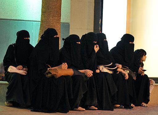 Saudi women wait for their drivers outside a shopping mall in Riyadh