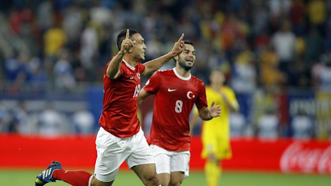 Turkey's Mevlut Erdinc, left, celebrates after scoring his team's second goal during a World Cup Group D qualifying soccer match between Romania and Turkey at the National Arena stadium in Bucharest, Romania, Tuesday, Sept. 10, 2013. Turkey defeated Romania 2-0