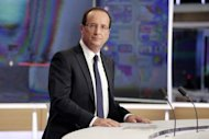 French President Francois Hollande appears on the French TV channel TF1. Hollande has pledged 30 billion euros in new taxes and savings to balance the budget and fund a turnaround in two years and rejected criticism of dragging his feet.