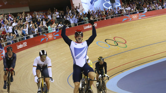 Britain's Chris Hoy celebrates after the track cycling men's keirin finals at the Velodrome during the London 2012 Olympic Games