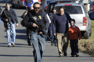 FILE - In this Friday, Dec. 14, 2012 file photo, parents leave a staging area after being reunited with their children following a shooting at the Sandy Hook Elementary School in Newtown, Conn., where Adam Lanza fatally shot 27 people, including 20 children. The Republican-led Senate voted Wednesday, Feb. 15, 2017, to block an Obama-era regulation that would prevent an estimated 75,000 people with mental disorders from being able to purchase a firearm. (AP Photo/Jessica Hill, File)