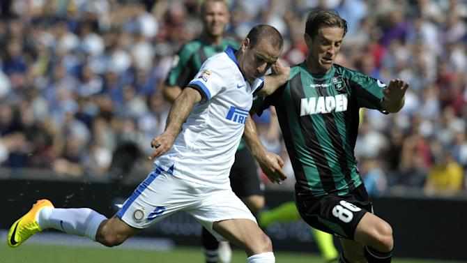 Sassuolo's Reto Ziegler of Switzerland, right, vies for the ball with Inter Milan's Rodrigo Palacio of Argentina, during their Serie A soccer match at Reggio Emilia's Mapei stadium, Italy, Sunday, Sept. 22, 2013