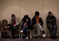 Relatives of Chinese passengers aboard the missing Malaysia Airlines Flight MH370 wait for a news briefing held by the airlines' officials at a hotel ballroom in Beijing Monday, March 17, 2014. The search for the missing Malaysian jet pushed deep into the northern and southern hemispheres Monday as Australia took the lead in scouring the seas of the southern Indian Ocean and Kazakhstan - about 10,000 miles to the northwest - answered Malaysia's call for help in the unprecedented hunt. (AP Photo/Andy Wong)