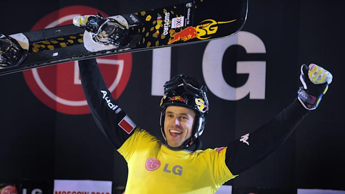 Italy's Roland Fischnaller celebrates after winning the men's parallel giant slalom event during the FIS World Snowboarding Cup in Moscow on March 3, 2012.  AFP PHOTO / ALEXANDER NEMENOV (Photo credit should read ALEXANDER NEMENOV/AFP/Getty Images)
