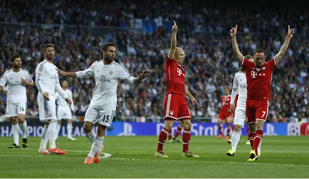 Bayern's Arjen Robben and Franck Ribery, right, react next to Real's Daniel Carvajal, during a first leg semifinal Champions League soccer match between Real Madrid and Bayern Munich at the Sa