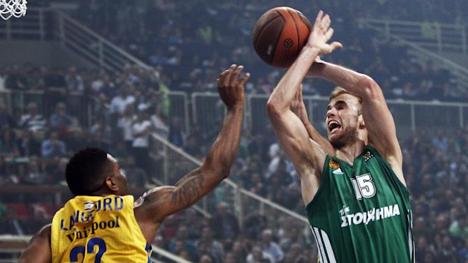 Panathinaikos' Nick Calathes (R) shoots as Maccabi tel Aviv's Langgord Keith (L) tries to block him during their Euroleague Basketball playoffs, game 5, in Athens on April 5, 2012.  AFP PHOTO / ANGELOS TZORTZINIS (Photo credit should read ANGELOS TZORTZINIS/AFP/Getty Images)