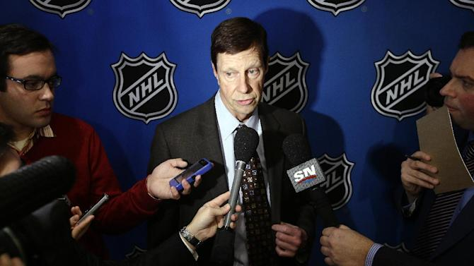 US hockey GM Poile can't go to Sochi after injury
