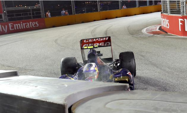 Toro Rosso Formula One driver Ricciardo crashes during the Singapore F1 Grand Prix in Singapore