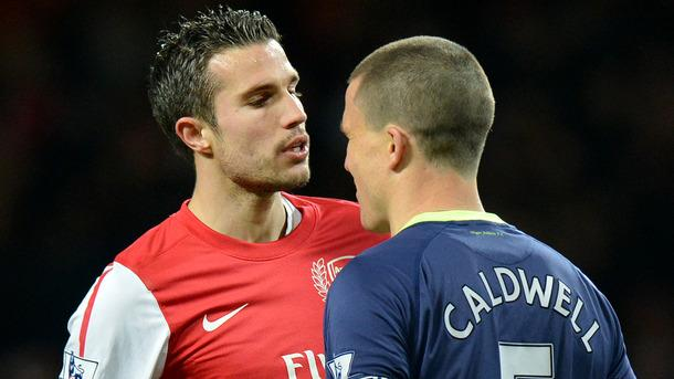 Arsenal's Dutch Forward Robin Van Persie (L) And Wigan Athletic's Scottish Defender Gary Caldwell (R) Clash    AFP/Getty Images