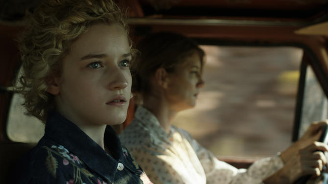 "This undated publicity film image released by Phase 4 Films shows Julia Garner, left, as Rachel, in a scene from the film, ""Electrick Children."" (AP Photo/Phase 4 Films)"