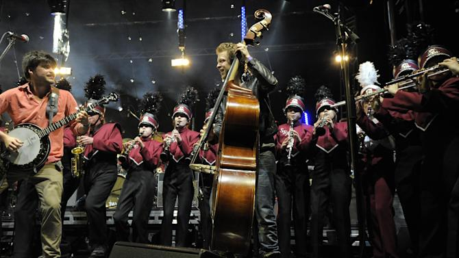 Mumford & Sons performs with the Austin High Marching Band at the Myspace Big Easy Express concert at SXSW in Austin, Texas, Saturday, March 17, 2012. (Jack Dempsey/AP Images for Myspace)